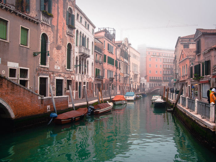 Water Nautical Vessel Canal Transportation Mode Of Transportation Building Exterior Architecture Built Structure Waterfront City Reflection Moored Nature No People Day Residential District Building Travel Destinations Gondola - Traditional Boat Passenger Craft Venice
