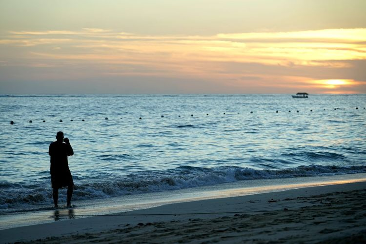 beach comber photo Beach Sea Sunset Silhouette Water Full Length Horizon Over Water Sand Vacations Standing People Scenics Tranquility Adult Sky Men Travel Destinations Wave Outdoors