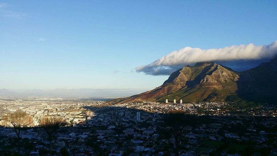 Clouds covering table mountain by residential district