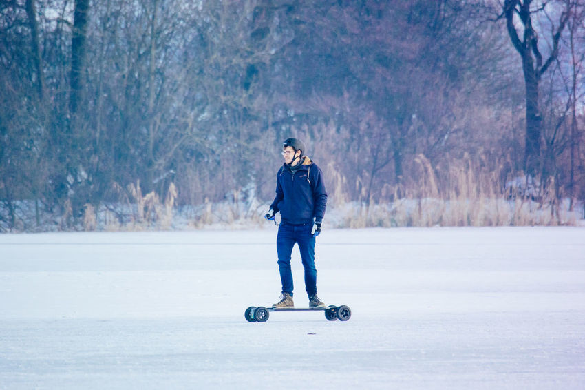 Adult Adults Only Cold Temperature Day Front View Frozen Full Length Ice Rink Ice Skate Leisure Activity Mauensee Nature One Person Outdoors People Snow Switzerland Tree Warm Clothing Winter Winter Sport