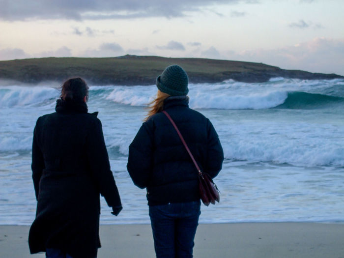 Casual Clothing Cold Friends Friendship Hebrides Lifestyles Nature Outer Hebrides Rear View Remote Scenics Scotland Sea Solitude Standing Three Quarter Length Togetherness Tourism Two Women Water Waves Winter Women