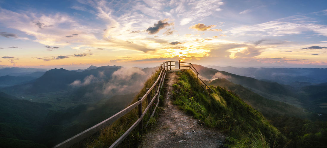 Beautiful Sunset in the mountains landscape,Thailand mountain scenic. Architecture Beauty In Nature Blue Bridge - Man Made Structure City Cloud - Sky Cultures Dark Darkness And Light Day Dramatic Sky Landscape Mountain Mountain Peak Mountain Range Nature No People Outdoors Scenics Sky Sunset Travel Travel Destinations