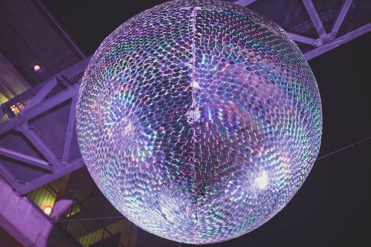 Illuminated Sphere Low Angle View Decoration Ceiling Lighting Equipment Pattern Night Hanging No People Disco Ball Indoors  Design Multi Colored Geometric Shape Shape Glowing Celebration Shiny Built Structure Light Nightlife Purple