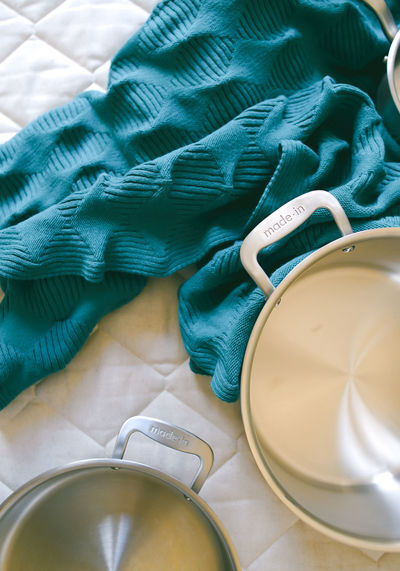 Indoors  Textile Still Life No People Table High Angle View Close-up Bed Cup Clothing Furniture Mug Day Green Color Pattern Book Blue Publication Selective Focus Clean