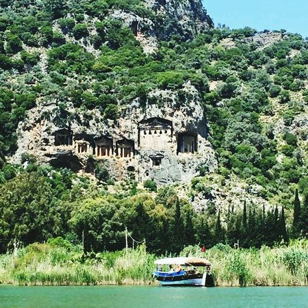 Nautical Vessel Water Transportation Outdoors No People Nature Natural Beauty Turquoise Water Boat Trip Green Water Turkey Türkiye Beauty In Nature Vacations Sky Nature Day Tombs Turkish History Rock Tombs Lycian Tomb Dalyan