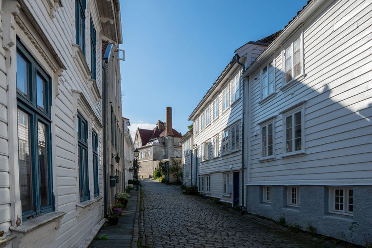 Stavanger - Norway Norway Stavanger Stavanger Norway Alley Architecture Building Building Exterior Built Structure City Clear Sky Day Direction Footpath House Nature No People Outdoors Plant Residential District Row House Sky Street The Way Forward Town Window