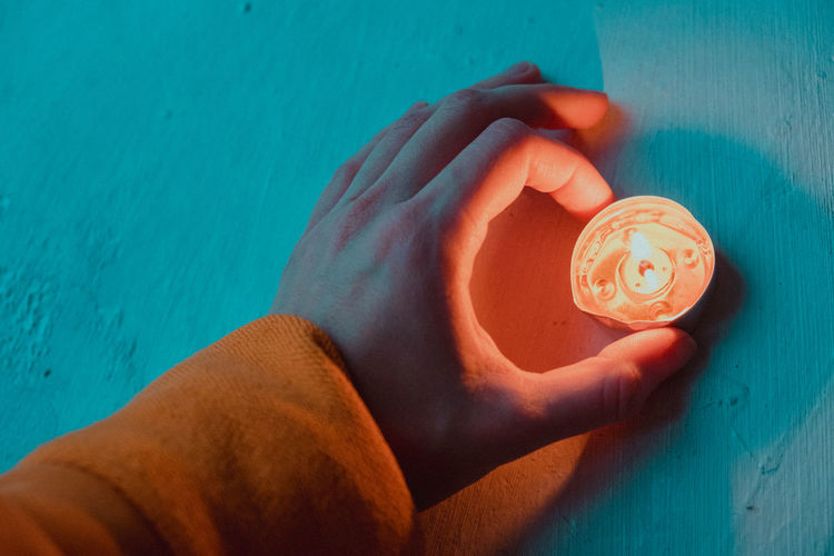 Candle light in your hand One Person Human Body Part Real People Human Hand Hand Personal Perspective Lifestyles Holding High Angle View Turquoise Colored Teal Orange Color Candle Light Candlelight Meditation