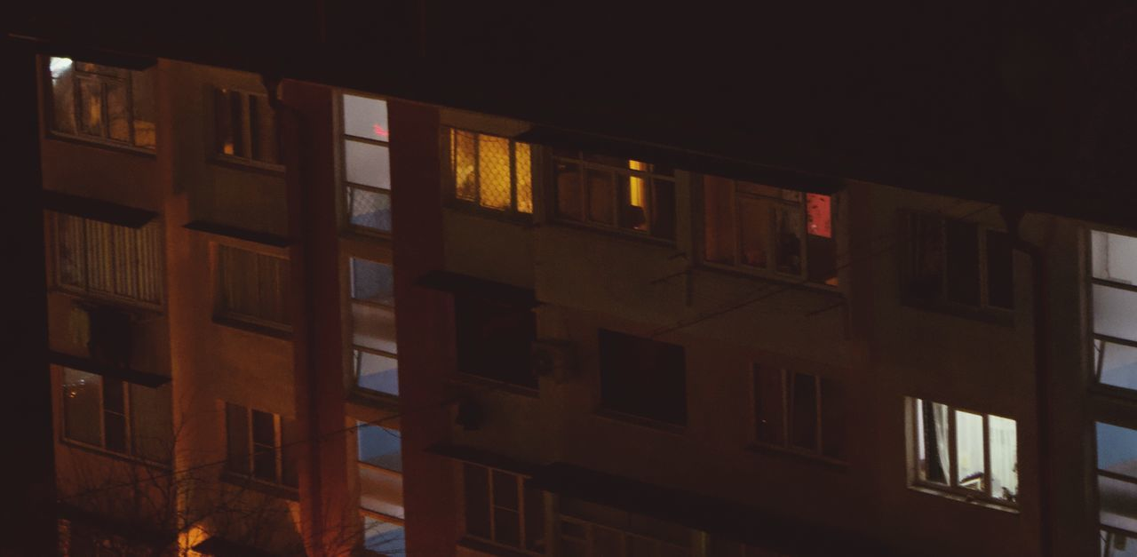 no people, built structure, architecture, building exterior, night, illuminated, low angle view, window, building, city, residential district, in a row, full frame, outdoors, multi colored, side by side, glowing, glass - material, lighting equipment, apartment