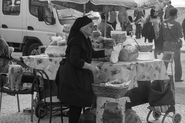 Blackandwhite Casual Clothing City City Life Day Full Length Holding In Front Of Lifestyles Market Vendor Men Mode Of Transport Outdoors People And Places Person Rear View Retail  Sitting Small Business Transportation