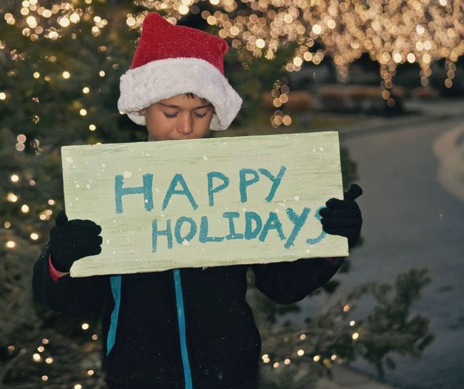 Holiday boy Children Christmas Time Is Here Elf Happy Holidays Holiday Season Holiday Concepts Images And Ideas Little Boys Seasons Colletion Trees A Holiday Message Childhood Holding A Seasonal Sign Holiday Collection One Person Outdoors Real People Santas Little Helper Seasons Greetings Signs And Banners Snowing Outdoors Text Warm Clothing Wearing Santa Hat Winter Wishing You A Merry Christmas