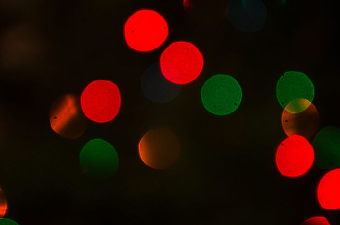 Smart Simplicity Christmas Backgrounds Black Background Bokeh Close-up Defocused Green Color Illuminated Multi Colored Night No People Outdoors Red