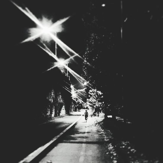 Walking and taking all of the emotion Night Street Light Dark City Life Illuminated The Way Forward Lens Flare Light Beam Outdoors Diminishing Perspective Footpath First Eyeem Photo