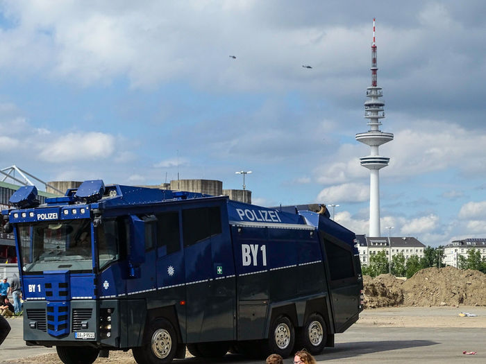 Water Cannon Truck Water Cannon Police Force Road Police City Closeout Vehicle Police Car Street Helikopter In Backround G20 Summit