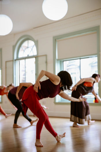 Nia Dancing Group Of People Indoors  Women Exercising Lifestyles Full Length Real People Practicing Education Young Women Sport Healthy Lifestyle Adult Balance Young Adult People Skill  Flexibility Togetherness Flooring