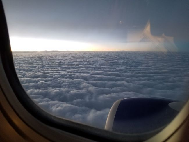 An ethereal plane of existence. Clouds Horizon Twilight Airplane Flying Commercial Airplane Water Air Vehicle Aerial View Sea Sunset Looking Through Window Jet Engine Foggy