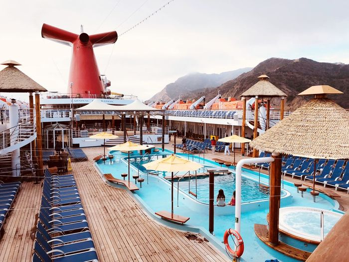 Poll deck on a cruise ship docked near the Catalina mountains Pool Outdoors Daylight Travel Destinations Cruise Ship Docking Cruise Ship Photos Mountains In The Background Pool Deck On Cruise Ship Vacation Destination Catalina Mountains  Catalina Island, Avalon, California Travel Destinations