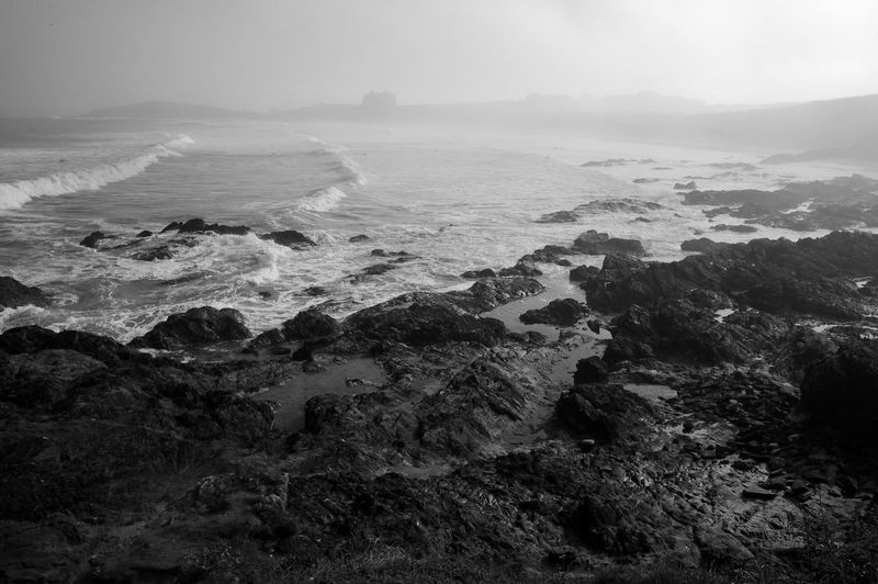 Waves In The Mist Sea Water Rock Solid Scenics - Nature Beach Beauty In Nature Land Sky Motion Wave Rocky Coastline Power In Nature Blackandwhite Black And White Newquay Fistral Beach