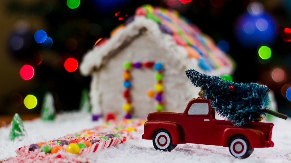 Gingerbread house Gingerbread Holiday Food Winter Snow Gingerbreadhouse Truck Gingerbread House Red Truck Background Christmas Bokeh Holidays EyeEm Selects Food Treat Bokeh Candy Cane Candy Toy Multi Colored Car Christmas Red Christmas Decoration Christmas Tree Toy Car No People