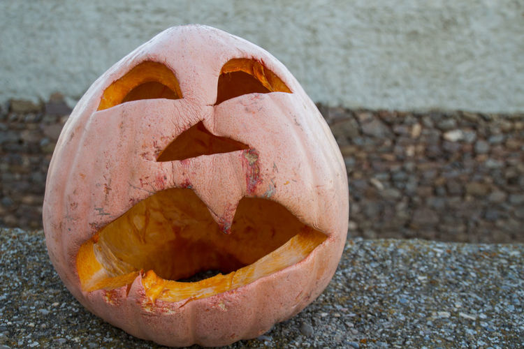 Close-up of pumpkin on pebbles