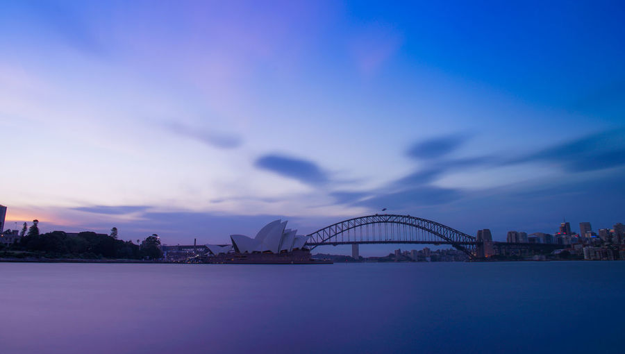 Twilight Skyscape: Sydney Harbour Bridge and Opera House Blue Dusk Colours Dusk In The City Long Exposure Long Exposure Night Photography Ocean Purple Sunset Sydney Harbour Bridge Sydney Opera House Sydney, Australia Twilight Twilight Sky