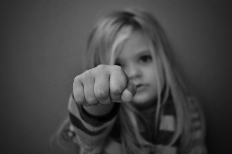 Cute girl clenching fist