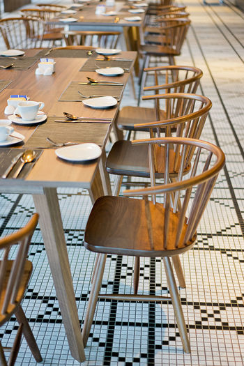 Row of chairs by table at restaurant