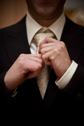 Midsection of businessman wearing suit