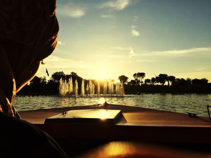 Boat Riyadh Saudi Arabia Water Sunset Sky Real People Nature Beauty In Nature One Person Headshot Leisure Activity Outdoors Lifestyles Tree Silhouette Scenics - Nature Plant Men Beach Sea