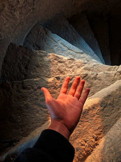 High angle view of person hand with sun light