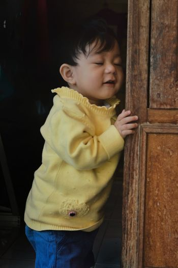 Cute boy looking at entrance to door