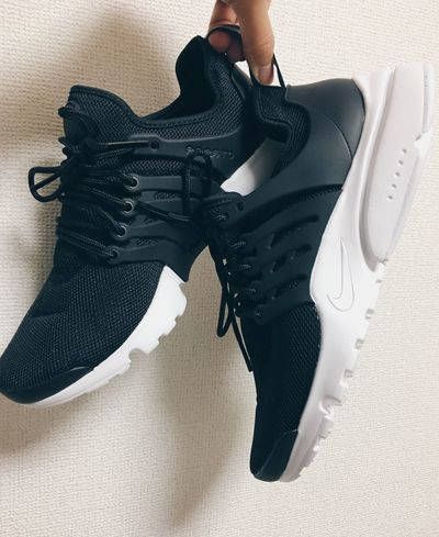 Out Of The Box Black Color Fashion Shoe Indoors  Human Body Part One Person Lifestyles Adult Women Well-dressed People Real People Close-up Adults Only Human Hand Day