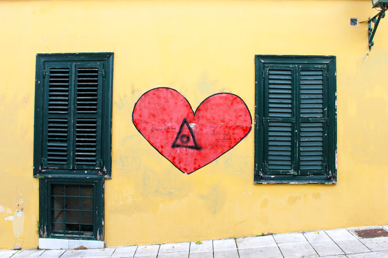 A Athens Athens, Greece Building Exterior City Greece Heart Love No People Red Heart Shutters Street Art Streetart Streetart/graffiti StreetArtEverywhere Streetphotography Wall Yellow Yellow Wall