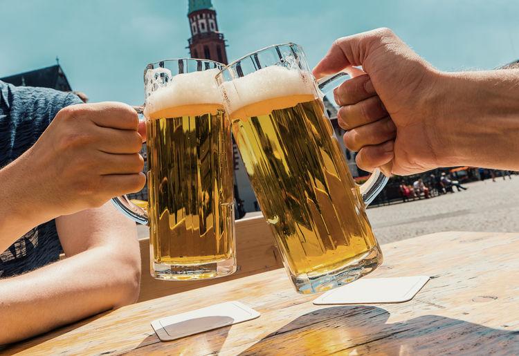 say cheers with german beer Beer Beer Garden Beer Glass Beer Time Beverage Cheers Drink Drinking Frankfurt Frankfurt Am Main German German Beer Glass Hand Human Hand Lifestyle Pub Pub Garden Summer Travel Travel Destinations