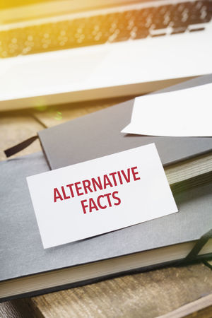 Alternative facts note on note pad in office desk Alternative Close-up Communication Concept Facts Indoors  Myths No People Red Reminder Story Symbolic  Text Truth Words