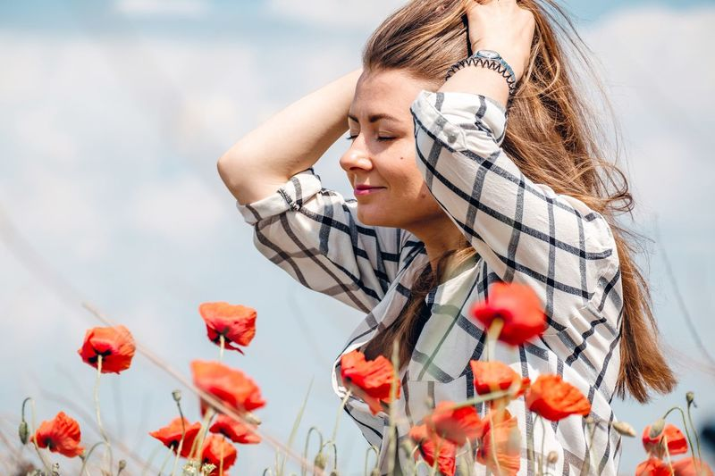 Beautiful smiling girl on the poppy field Poppy Closed Eyes Happiness Smiling Sunshine Springtime Spring Poppy Fields Poppy Flowers Young Adult Nature One Person Plant Portrait Young Women Headshot Beauty In Nature Real People Women Flower Sky Lifestyles Beauty Flowering Plant Low Angle View Adult Looking Outdoors Contemplation