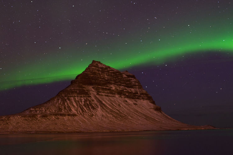 Northern lights behind Kirkjufell mountain, pt. 3 Kirkjufell Iceland Aurora Borealis Northern Lights Night Scenics - Nature Beauty In Nature Star - Space Space Astronomy Sky Idyllic No People Water Mountain Environment Capture Tomorrow EyeEmNewHere