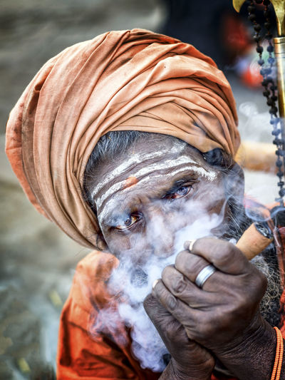 Close-Up Of Man Smoking Pipe