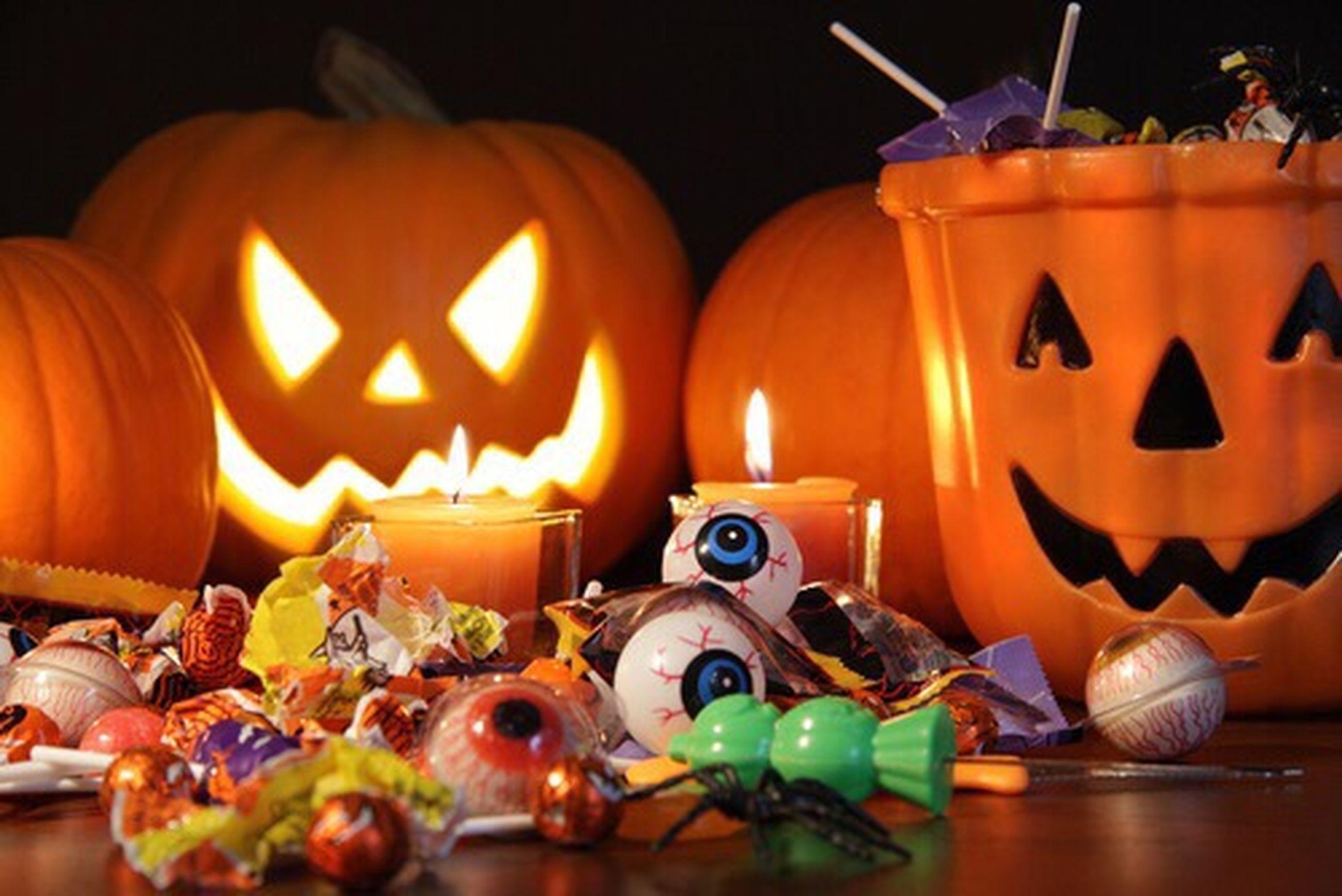 indoors, pumpkin, flame, illuminated, still life, close-up, art and craft, human representation, candle, halloween, art, burning, creativity, orange color, decoration, food, night, no people, tradition