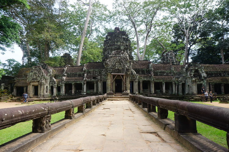 Ancient Ancient Civilization Architecture Built Structure Cambodia Centered Temple Centred Temple Khmer No People Old Ruin Path To Ruin Path To Temple Religion Ruin Sculpture Spirituality Travel Destinations Wooden Rails