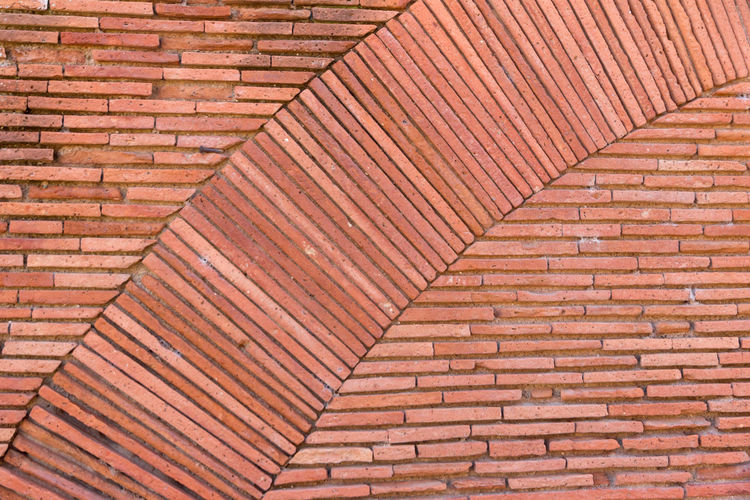 Brickwork patterns Architecture Backgrounds Brick Brick Wall Brown Building Exterior Built Structure Day Full Frame No People Outdoors Pattern Red Repetition Roof Roof Tile Sunlight Textured  Wall Wall - Building Feature