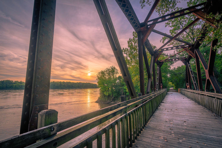 Biking Architecture Beauty In Nature Bridge Built Structure Cloud - Sky Connection Nature No People Orange Color Outdoors Railing Scenics - Nature Sea Sky Sunset Trail Tranquil Scene Tranquility Tree Water Wood - Material