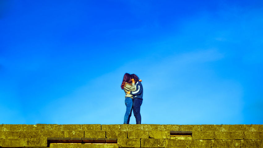 Hug Love Architecture Beauty In Nature Blackandwhite Blue Clear Sky Day Field Full Length Landscape Leisure Activity Lesbian Lgbt Lifestyles Lovebirds Low Angle View Nature One Person Outdoors People Real People Sky Standing Young Adult Press For Progress