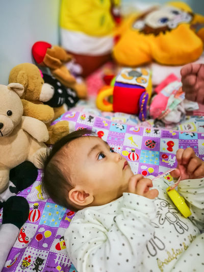 9 month old baby is lying down on a bed with full of toys at a clinic. Lying Down Toys Pediatrics Clinic Asian Baby Girl Asian  Vaccination Vaccine Vaccines Asian  Asian Family Baby Children Doctor  Family Family❤ Asian Children Clinic Infant Kid Prevention Sick Sick :( Treat Vaccination 6-11 Months Baby Girls One Baby Girl Only Babyhood 0-11 Months