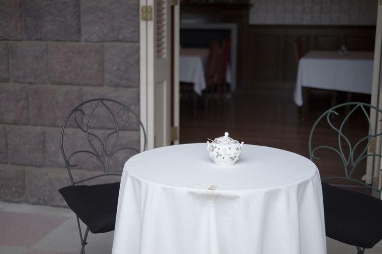 Sugar bowl on white tablecloth