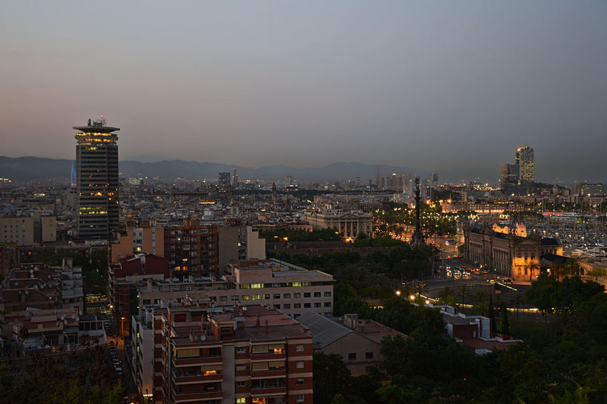 Barcelona's city scape by night Barcelona Night Lights Night Photography Nightphotography Apartment Architecture Building Building Exterior Built Structure City City Life Cityscape Crowd Crowded Dusk High Angle View Night Outdoors Sky Skyscraper Sunset