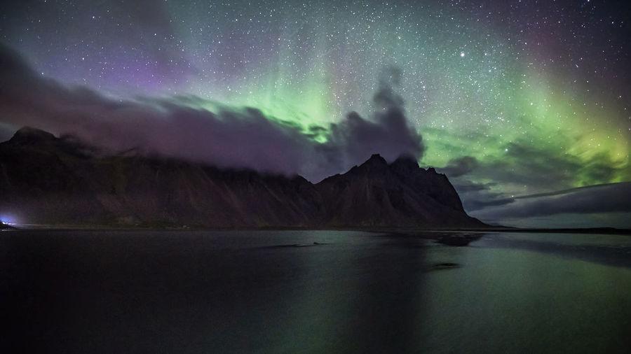 Aurora display at vestrahorn mountain in stokksnes, iceland