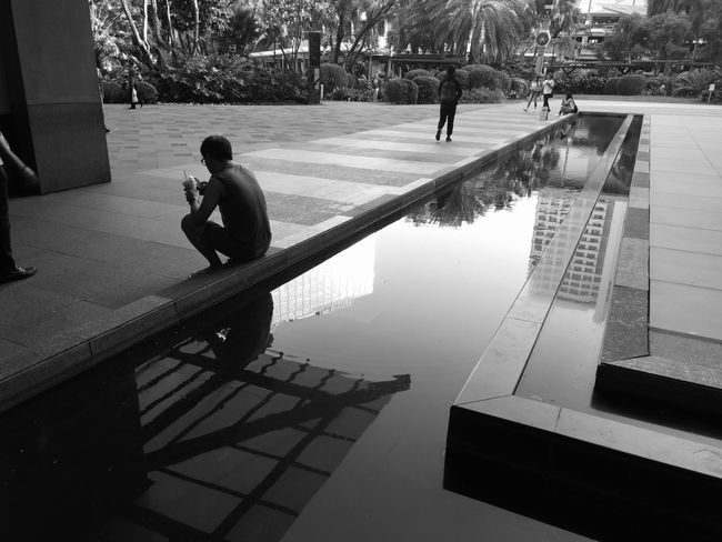 downtime..... Shotwithhuaweimate9 Huaweimobile Huawei Photography Mobile Photography Huawei Mate 9 Huaweiphotography No Edit Smartphone Photography Eyeem Philippines People City Life Huaweimate9 Kokopaps Adults Only City Urbanscape Black & White Black And White Sitting Water Reflections