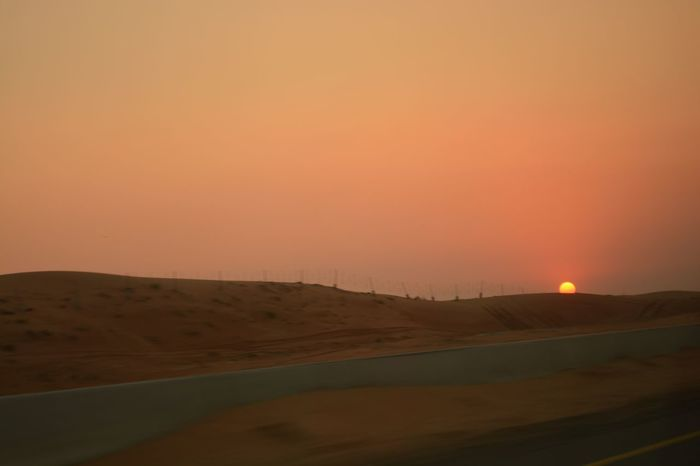 Sunset Sand Orange Color Landscape Nature Scenics Beauty In Nature Clear Sky No People Outdoors Day Rural Scene Hello World Eyemphotography Abudhabi Desert Beauty Sky EyeEm Best Shots Movingshot Highway Sun