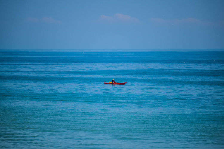 Beauty In Nature Blue Blue Sky Day Horizon Over Water Leisure Activity Men Nature One Person Outdoors Paddleboarding People Real People Scenics Sea Seascape Sky Water Waterfront