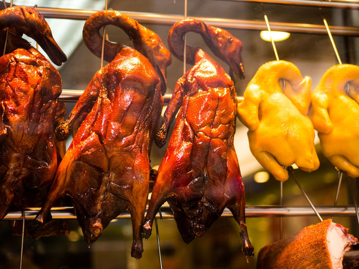 Close-Up Of Roasted Ducks Hanging At Market